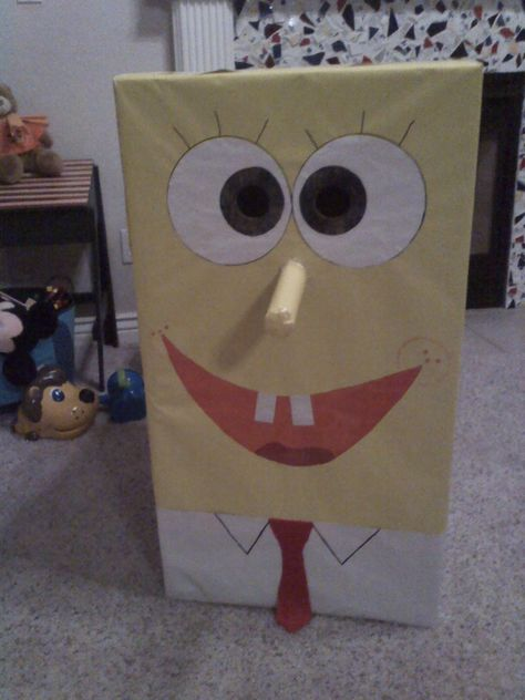 My son used to love spongebob. For his first birthday we made this out of a box using wrapping paper and felt for the tie. My husband was home on leave from Iraq and he put this on with brown shorts. My son was so excited that Spongebob came to his party