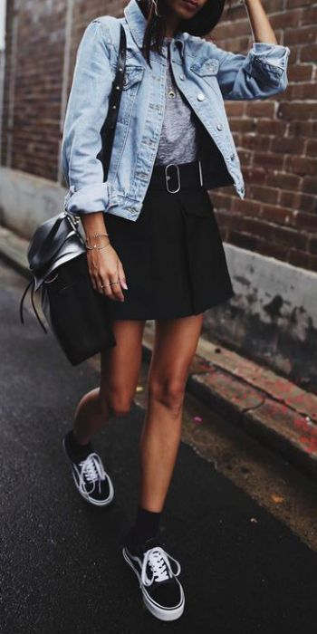 Andi + mastered + mini skirt trend + gorgeously simple black piece + statement belt + casual tee + understated + street-ready look + or boots + Andi's casual vibe Tee/Skirt: Acne, Jacket: Topshop, Shoes: Vans.
