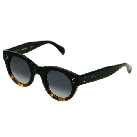 4bbaa0f891 Retro round cat eye ladies  sunglasses from Celine. Black frame with  tortoiseshell accents and metal pin detail on each temple. Black smoke  gradient lens.