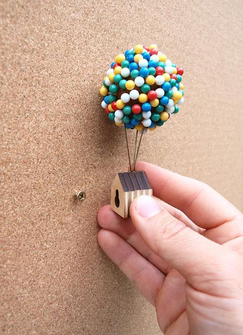 Whether you need to pin up a pin-up, or drop a pin on a map, the Balloon Pin House provides an enchanting place for you to store your map or noticeboard pins. 300 individual pins float above a tiny rooftop in a miniature balloon cluster. Arrange your balloons by simply pressing each pin