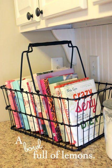 Cookbooks in a basket (on top of fridge)