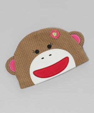 Nestle little noggins into this adorably knit beanie. Designed after the ever-joyful sock monkey, it'll keep cuties warm while getting them ready to play.