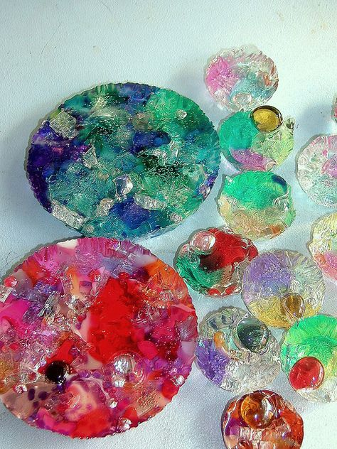 Plastic items melted in muffin tins in a toaster oven. ooo the ideas! I want to find an old heart shaped tin now! I am going to make these for sure i gots tons of plastic stuff hanging around