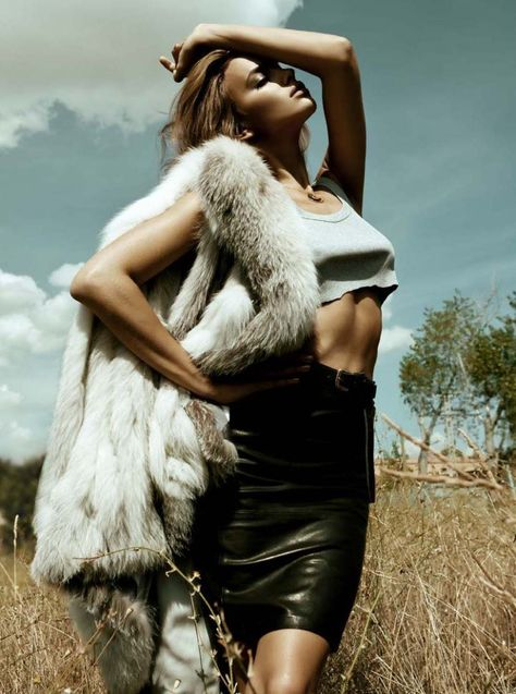 Posture/pose- I love the angle of this photo and how the setting works great with the animal skin she's wearing.