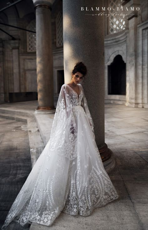 Wedding dress Nilsa by Blammo-Biamo. Plunge V-neck embellished bodice skirt cape A-line luxury stylish wedding dress. Ship worldwide. Based in Vancouver, Canada.