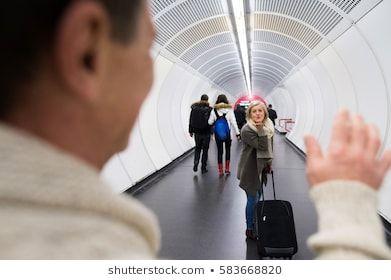 Senior Couple In Hallway Of Subway Saying Goodbye 60s Austria