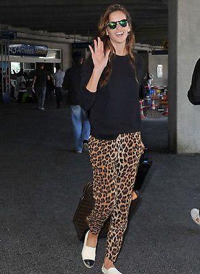 Izabel Goulart in a black tee + leopard-print drawstring pants + Chanel espadrilles