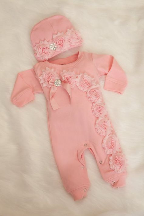 Super soft adorable pink little romper set for your little baby.. Chiffon is on the chest with rhinestone ribbon , bottom of the leg and sleeves.. super cute:)... Bottom has snaps for easy dressing. Comes with matching hat...wanted to make a simpler version of what I already