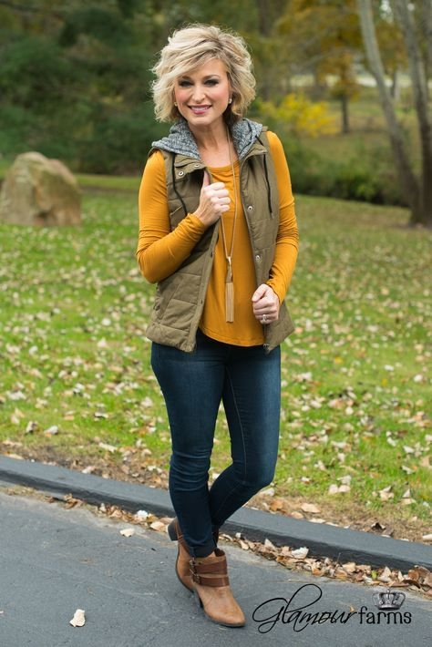The Garrett Vest is a wardrobe must-have! This padded vest has a bonus two-for-one attached hoodie for keeping you casual but in true style. Snap and zipper closure, side pockets and and soft, curved Kleider formell Glamour Farms Boutique Vest Outfits For Women, Casual Fall Outfits, Fall Winter Outfits, Cute Outfits, Clothes For Women, Summer Outfits, Fashion Over 50, Look Fashion, Autumn Fashion