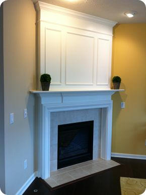 Thrifty Decor Chick: A fireplace redo! I hate that big awkward space above our corner fireplace!