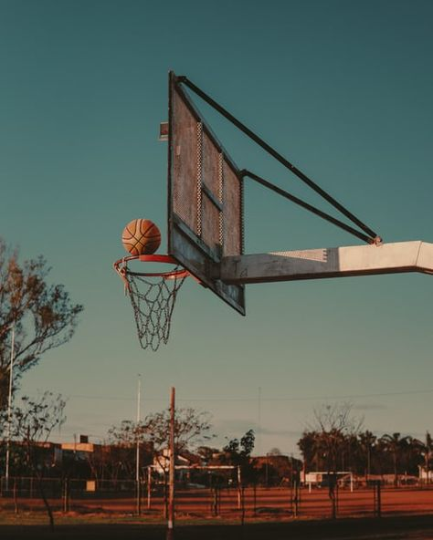 low angle photo of white and black metal portable basketball hoop under cloudy sky during daytime photo – Free Basketball Image on Unsplash Basketball Pictures, Love And Basketball, Basketball Hoop, Free Basketball, Character Aesthetic, Aesthetic Photo, Aesthetic Pictures, Aesthetic Backgrounds, Aesthetic Wallpapers