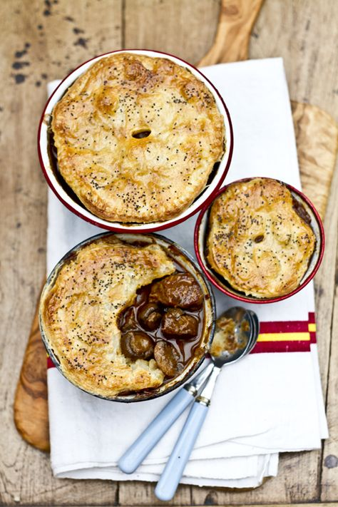 """Beef, Guinness and Mushroom Pot Pie... and just listen to how adorably British the author of this blog is:  """"Winter is not over yet. Before we go a little too crazy with health kicks after holiday excesses, lets make a few more stews, pies and mash.""""  Amen to that!"""