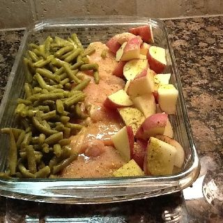 4 raw chicken breasts, new potatoes, green beans. Arrange in 9x13 dish. Sprinkle with a packet of Italian dressing mix and then top with a melted stick of butter. Cover with foil and bake at 350 degrees for 1 hour. Enjoy!