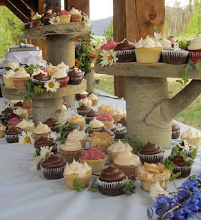 mountain rustic wedding at windy point campgrounds near lake dillon and breckenridge, cupcakes adorned by wildflowers