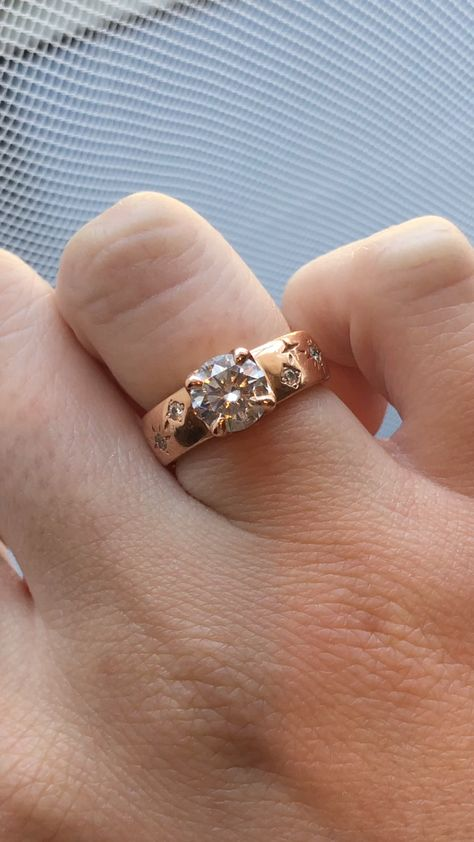 This ring features the couple's zodiac constellations on either side. This ring was custom designed by Abby Sparks Jewelry. #moissanitengagementring #constellationmoissaniteengagementring #rosegold