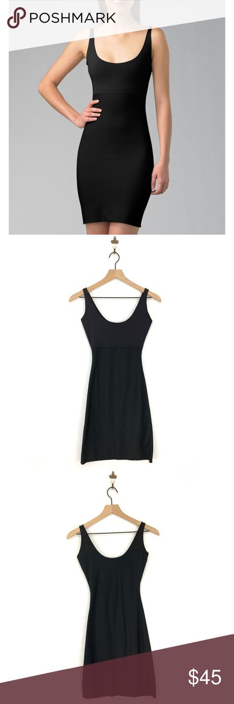 Spanx Black Hide & Sleek Full Slip Dress Small Fitted; Scoop neck; Slick fabric won't cling to clothes; Shapping Slip  Condition: No Rips; No Stains  Polyester Blend   •Orders are shipped within 24hrs! {Weekends & Holidays Excluded}  •Offers are welcomed • Bundle & Save • SPANX Intimates & Sleepwear Chemises & Slips