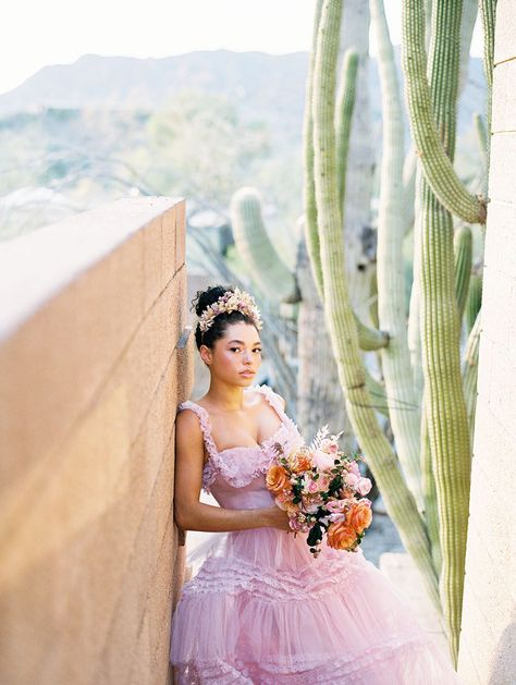 Not to be dramatic, but this desert bridal session with a lavender wedding dress is the greatest thing we have seen all year. Fun and flirty with just the right amount of edge, these bridal portraits on a modern Arizona property designed by Frank Lloyd Wright could convince anyone that a colorful bridal gown is the way to go. If you consider yourself a fan of pastel wedding colors, vintage fashion and cactus landscapes, head over to Ruffled Blog now to see this modern romantic wedding gallery in
