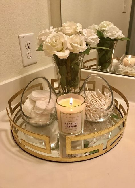 IM OBSSED with the bathroom piece I put together. -Gold Tray: kirklands -Glass … IM OBSSED with the bathroom piece I put together. -Gold Tray: kirklands -Glass containers: TJ Max -Candle: target Source by Bathroom Countertops, Bathroom Cabinets, Countertop Decor, Organize Bathroom Countertop, Restroom Cabinets, Vanity Countertop, Bathroom Shelves, Glass Shelves, First Apartment