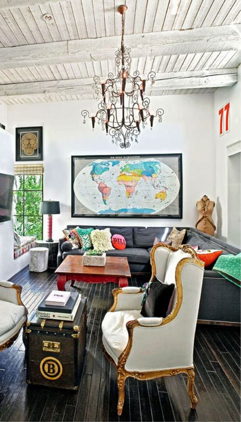 dark floors, light neutral walls, and tons of bright colorful eclectic decor