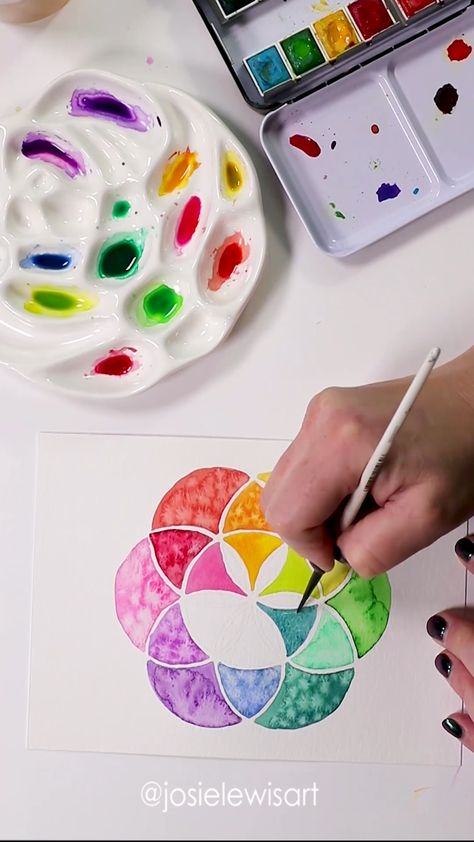 watercolors in a seed of life design with watercolor crystals and rainbow, click to see relaxing watercolor compilation