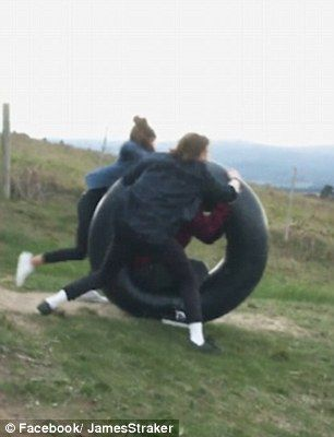 Moment Man Rolling Downhill In A Tire Tube Nearly Hit By A Car