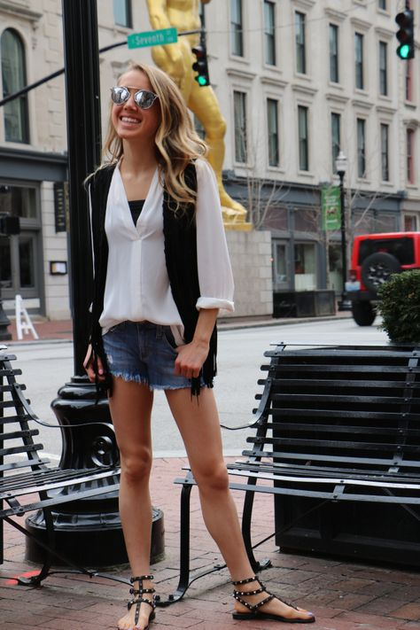 f4459cc2e Spring Festival Ready with Denim Cut-Off Shorts, Black Fringe Suede Vest,  and Rockstud Valentino Sandals // snapped by gracie