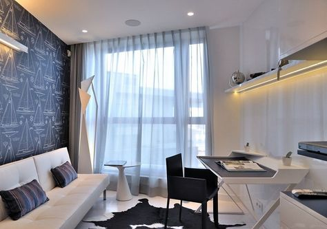 Bureau maison noir et blanc avec meubles modernes et déco en