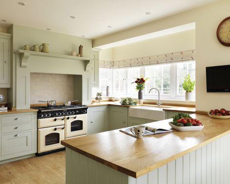 photo of farmhouse farmhouse kitchen shaker traditional warm sage sage green harvey jones kitchen with belfast sink white walls and range co...