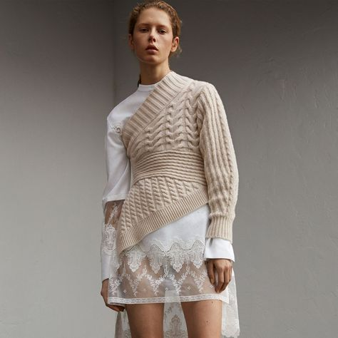 A cashmere sweater created from a collage of cable and rib knits with a flattering cinched waist. Revealing elements of garments worn underneath, the cropped, asymmetric shape is cut to reflect Henry Moore& sculptural forms.