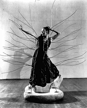 Martha Graham in Medea's dress from Cave of the Heart. Stage set designed by Isamu Noguchi, 1946.