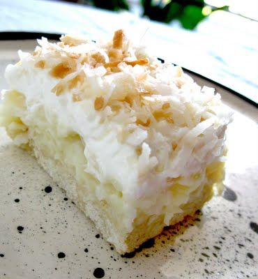 Coconut Cream Pie baked in a 9 x 13 and cut into bars
