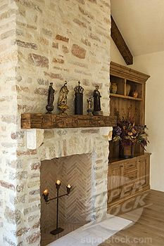 light stone fireplace...love the tile in the fire chamber! This is a beautiful fireplace!!!