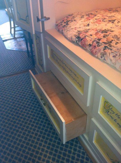 I would have the platform that holds the mattress come out above the under-bed storage and pull outs that stored seasonal bedding, and other 'stuff' that gets used only sometimes, but is necessary, under the platform.