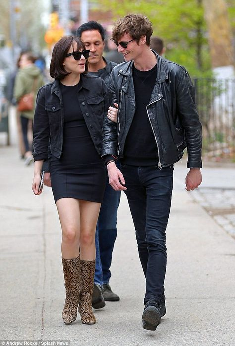 Together: Arm in arm as they walk along, Dakota Johnson send a clear message that it's back ON with boyfriend Matthew Hitt in New York on Monday. Them #boots... #DakotaJohnson #fashion #movies