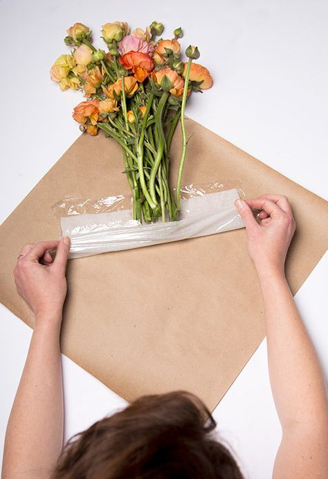 How to wrap your bouquets and also keep them fresh with a genius trick so you can show up with something happy at your dinner party or wedding