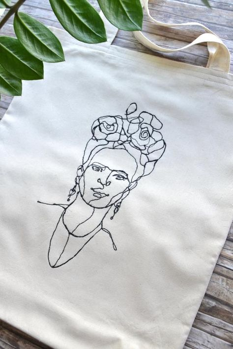 Freehand Embroidered Tote Bag, Frida Kahlo Line Art Happy to announce that our Best Selling Tote Bag is back on stock on our shop: Anafi Freehand Embroidered Tote Bag, Woman's Figure New Design Diy Embroidery Shirt, Embroidery On Clothes, Hand Embroidery, Embroidery Designs, Diy Tote Bag, Fabric Bags, Printed Bags, Diy Clothes, Line Art