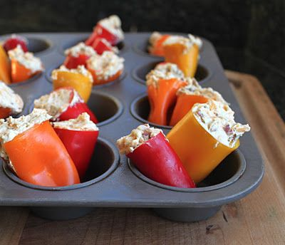 OMG I want these in my mouth. Lol.    Stuffed Mini-sweet pepper  1 lb. mini sweet peppers (about 22-24 peppers) 8 ounces cream cheese, softened 1/2 t garlic powder 1 t seasoned salt 1 1/2 C shredded, sharp cheddar cheese 5 slices bacon, cooked and crumbled  Bake @ 350 for 20 mins!