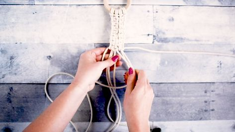 """Using a few different classic macrame knots, create your own hanging mirror and plant holder (plus extra macrame cord for another project of your choice). Included in this kit is 50 yds of macrame cord, a 10"""" hexagon mirror, wood ring, wood dowel, wood beads, clipboard,  mason jar, artificial eucalyptus leaves, and a measuring tape."""