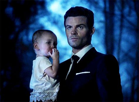 Awwww Elijah with baby hope
