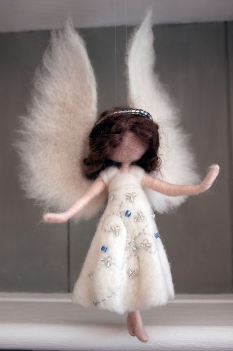 A cute little needle felted Waldorf inspired angel, made to order in about a week, customised with your choice of colours and other details. Custom orders are always OOAK. Made from ethically sourced non-mulesed merino and sometimes locally produced mohair or alpaca. Her needle felted wings are wired and so are poseable, as are her arms, legs and neck. She has a silver or gold thread hanging loop or invisible thread. She is about 25cm tall ((excluding hanging thread). Please let me know yo...