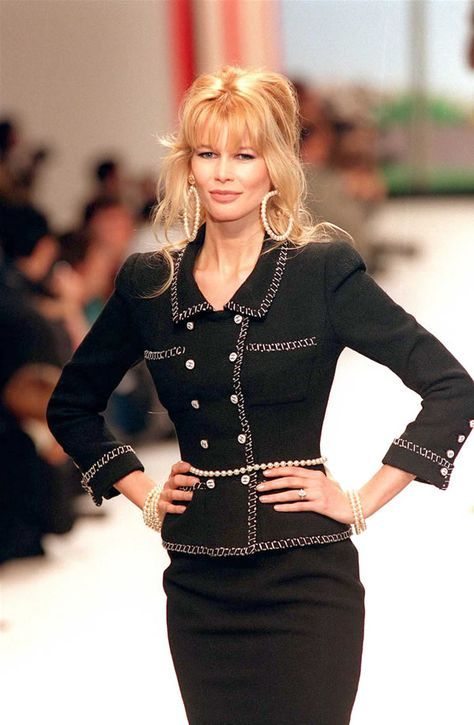 German top-model Claudia Schiffer displays 24 January 1995 in Paris a black tweed suit embroidered with a white and black braid designed by Karl Lagerfeld for 1995 Spring/Summer Haute-Couture. Get premium, high resolution news photos at Getty Images