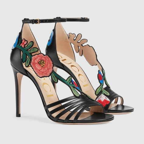 3b12bf95c Shop the Embroidered leather mid-heel sandal by Gucci. A mid-heel sandal  with an intricately designed floral embroidery that extends around the  outside of ...