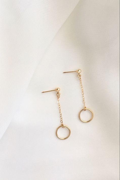 Polish off your look with these minimalist open circle dangle earrings. These understated earrings are comfortable and lightweight. A chic everyday favorite to dress up any outfit. Shop the IB Jewelry collection at ivolvebeauty.com. #jewelryinspo #minimalistearrings #dangleearrings #everydayjewelry #minimalistjewelry #minimalistlook #wardrobeessentials #daintyjewelry #minimalfashion #styleinspiration #basicwardrobe