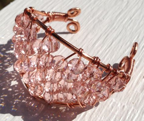 """""""Pink Champagne"""" Copper and crystal wire wrapped bracelet. I'm a big fan of this organic. shabby-chic look. This free-form wire wrapped bracelet was made from 10 and 20 gauge pure copper wire. Crystals are 10mm Czech rondelles."""