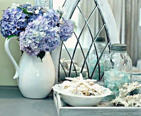 Shabby Sweet Cottage:  pretty summer decor: hydrangeas in a pitcher, shells in a bowl, and sea glass in a ball jar