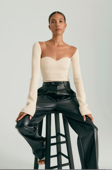 Moda Operandi Muses TyLynn Nguyen - Black leather trousers. Longsleeve nude top with shoulder/collarbone cut out. White sandals. Sleek hair.