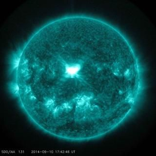 An X1.6 class solar flare flashes in the middle of the sun in this image taken September 10, 2014, in this image courtesy of NASA.  REUTERS/NASA/SDO/Handout