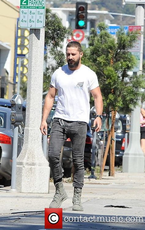 LaBeouf sports a beard and military boots out on La Brea Avenue GQ always talks crap about the way he dresses but I think it looks dope.GQ always talks crap about the way he dresses but I think it looks dope.