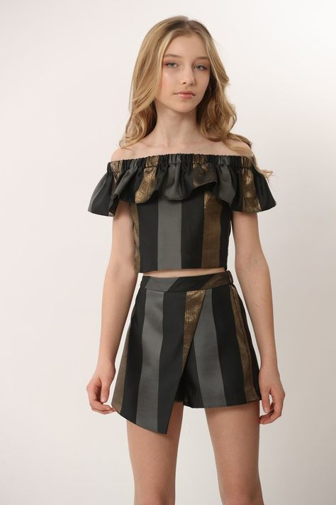 Striped off the shoulder top with matching wrap style skort. This has a gold metal exposed zipper at back. Elastic @ back of skirt with side zipper.