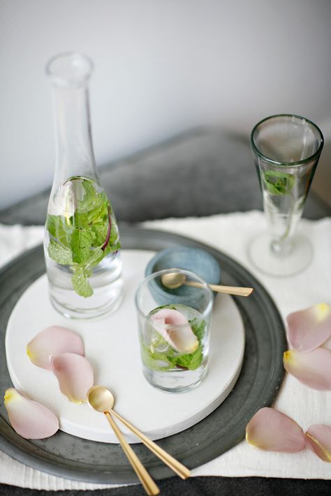 Minted Rose Water: 2 cups of cool water, a quarter teaspoon of Rosewater, two sprigs of Mint, and a few rose petals